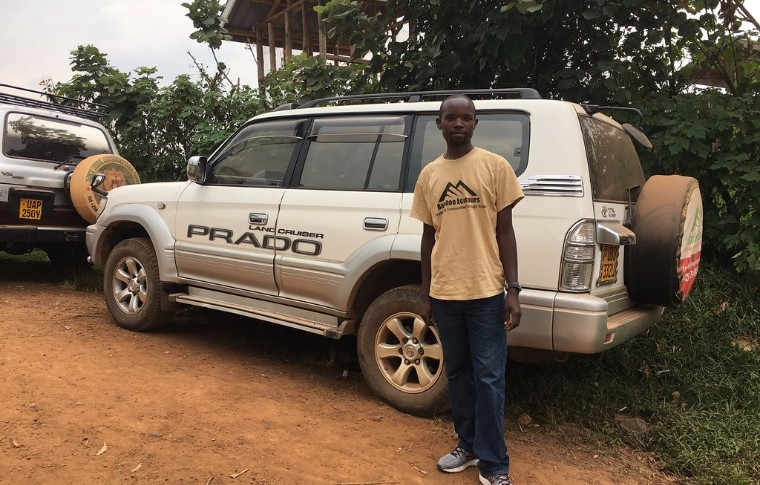 One of the guides at Bamboo Ecotours stands by the 4 x 4 vehicle.