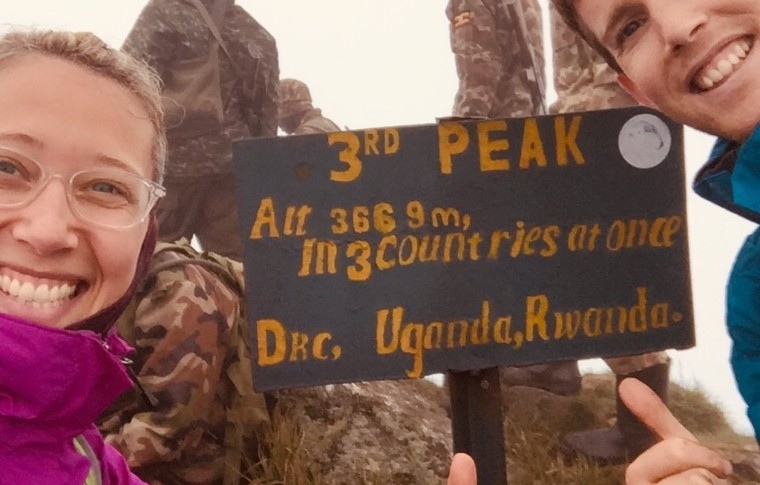 Guests pose with a sign for the volcano trek.