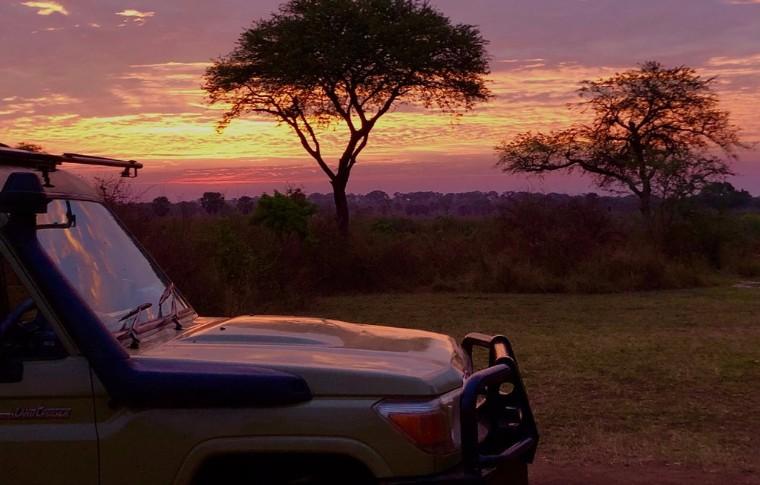 The sun sets over the plains of Uganda.