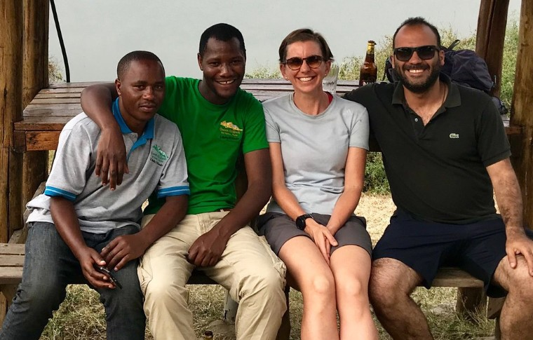 Guests pose with the tour guides of this Uganda tour operators Bamboo Ecotours.