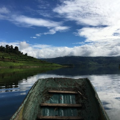 The bow of a boat as it glides through Lake Mutanda.
